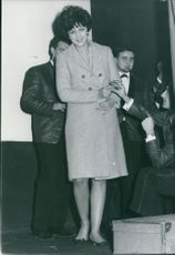 Radmila Mikic standing and smiling on camera.