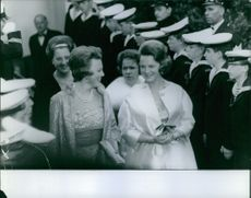 Princess beatrix of the Netherlands together with an important woman.