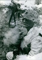 Soldier relaxing and smoking during wartime.