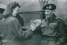 Field Marshal Montgomery leaves over a bouquet of flowers to a pond