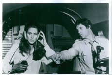"""A scene from the film """"Airplane!"""" casting by Julie Hagerty with Robert Hays,  1980."""