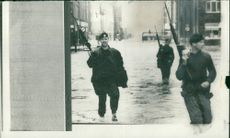 Floods 1966-1989:Troops playing a double role.