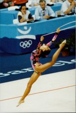 Belgian gymnast C. Stollenberg at the Olympic Games in 1992.