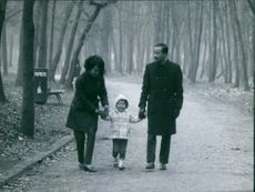 Nguyễn Cao Kỳ and his wife Đặng Tuyết Mai taking a stroll with their child. 1968.