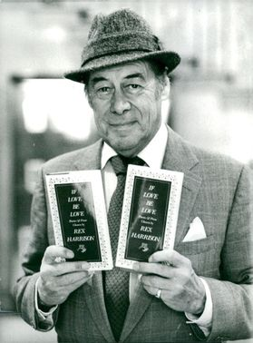 """Rex Harrison with his poetry book """"If Love Be Love"""""""