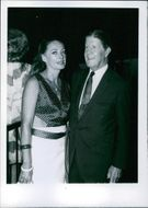 Mr. and Mrs. Rudy Vallée at the cocktail party at Holiday Inn in Hollywood. 1970.