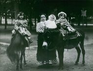 Andrée-Defferre Aboulker, with her kids riding two ponies. May 28, 1969.