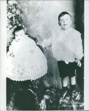 Photograph of boy and babygirl together.
