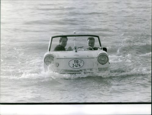 A vintage vehicle floating on the water. August 11, 1952