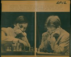 Anatoly Karpov makes a move in match of Johann Hjartarson of Iceland.