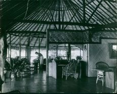 A photo of a woman doing things in her nipa hut house in modern design.
