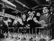 People while singing church hymns as they attend mass headed by Pope Paul VI.  Taken - 7 Jan. 1969