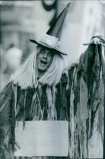 A guy in a wizard costume pose for the camera.