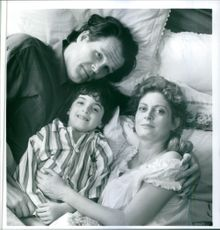 A scene from the movie Lorenzo's Oil, with Susan Sarandon as Michaela Odone, Nick Nolte as Augusto Odone and Zack O'Malley Greenburg as Lorenzo, 1992.