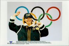 Tea Satoya shows up the gold medal in freestyle skiing during the Winter Olympics 1998.