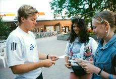 Tomas Brolin writes autographs