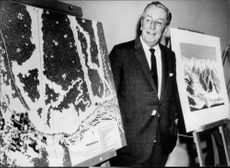 """Walt Disney at the paintings """"The Wizard's Apprentice""""."""