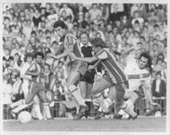 John Trewick, Gary Owen and Gerry Francis are fighting for the ball