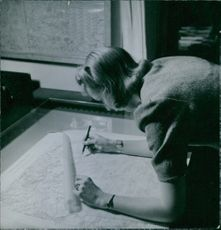 1940 Woman taking an impression of a map.  Library King