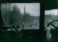 Man driving the truck on the road. 1942