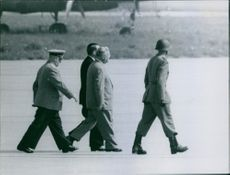 Nikolai Bulganin is walking with the soldiers. 1955