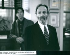 """Ron Rifkin and Timothy Hutton (background) in Daniel Sullivan's """"The Substance of Fire""""."""