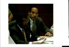 Defendant OJ Simpson sits with his lead attorney Johnnie Cochran.