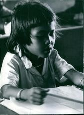 A child studying.