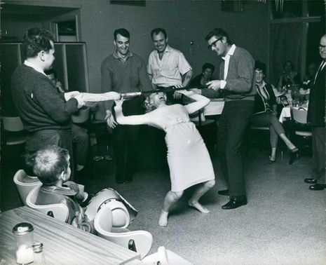 Carroll Baker playing game with men.