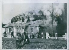 A burning house during Yugoslav war, 1942.
