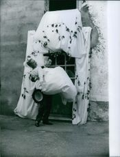Jean-Claude Bujard carrying Geneviève Page on their wedding day.