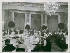 People gathered in a Palace of Prince of Bismarck during a party.