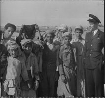Telegraphist Forssberg with interested Iranian youth during the test flight stop in Tehran.