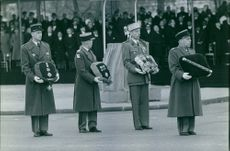Soldiers holding medals.