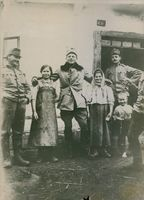 Soldiers standing with the civilian in Poland during the WWI, 1915.