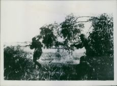 1942 Red Army maintains fierce resistance at Tzimlyanskaya. Soldiers and rifleman holding rifle and running beside the bank of river, fighting and firing.