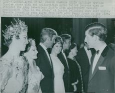 Prince Charles of Wales talks with the dances of the Fall in The Star at the London Palladium.