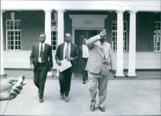Joshua Nkomo, leader of the African National Council (ANC), giving a victory salute to waiting supporters as he leaves the Prime Minister's Office in Salisbury, after the latest round of talks on Rhodesia's constitutional future with Ian Smith, 1976.