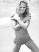 Norwegian actress Julie Ege poses on the beach.