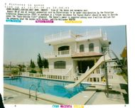 View of house and swimming pool.