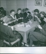Women sitting together and knitting.