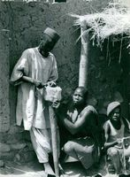 A family weaving for a living.