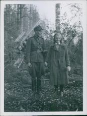 Soldier standing with a woman in the forest during the war in Finland, 1942.