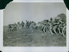 Photo of military officials checking on the bicycles.