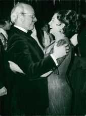 """Jean Simmons is dancing with the director of the musical """"A Little Night Music"""" after the premiere"""
