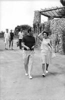 Princess Margaret, walking with a man.