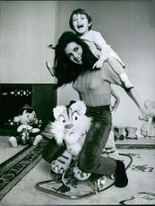 Danièle Gaubert playing with her child, 1967.