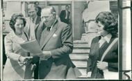 Viscount William Whitelaw receiving a peace petition