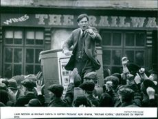 A scene showing Liam Neeson giving his speech in front of the audience in Michael Collins.