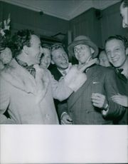 Swedish actor and comedian Nils Poppe being photographed enjoying a moment with his friends.1942.